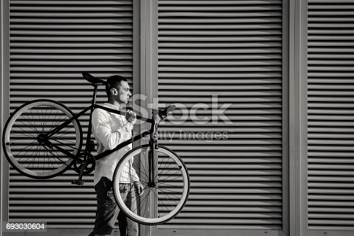 812812808istockphoto Man with bicycle 693030604