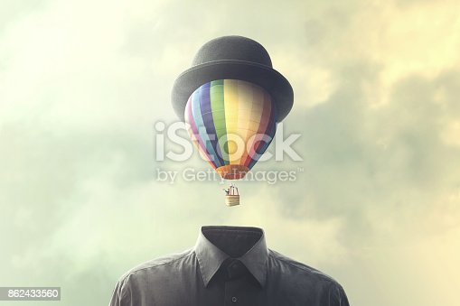 861862204 istock photo man with big balloon fly on his head, changement concept 862433560