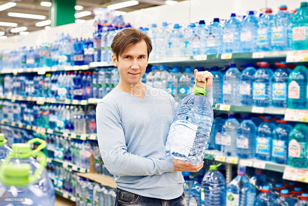 Man with big bottle drinking water stock photo