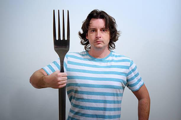 Mann mit big fork als Neptune trident – Foto