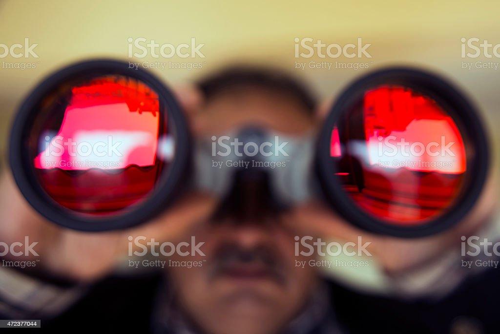 Man with binoculars. stock photo