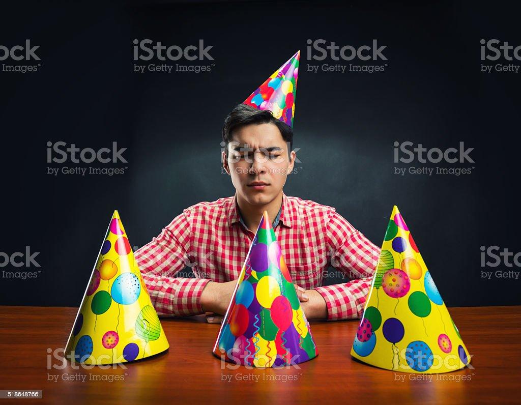 Man with Birthday hats stock photo