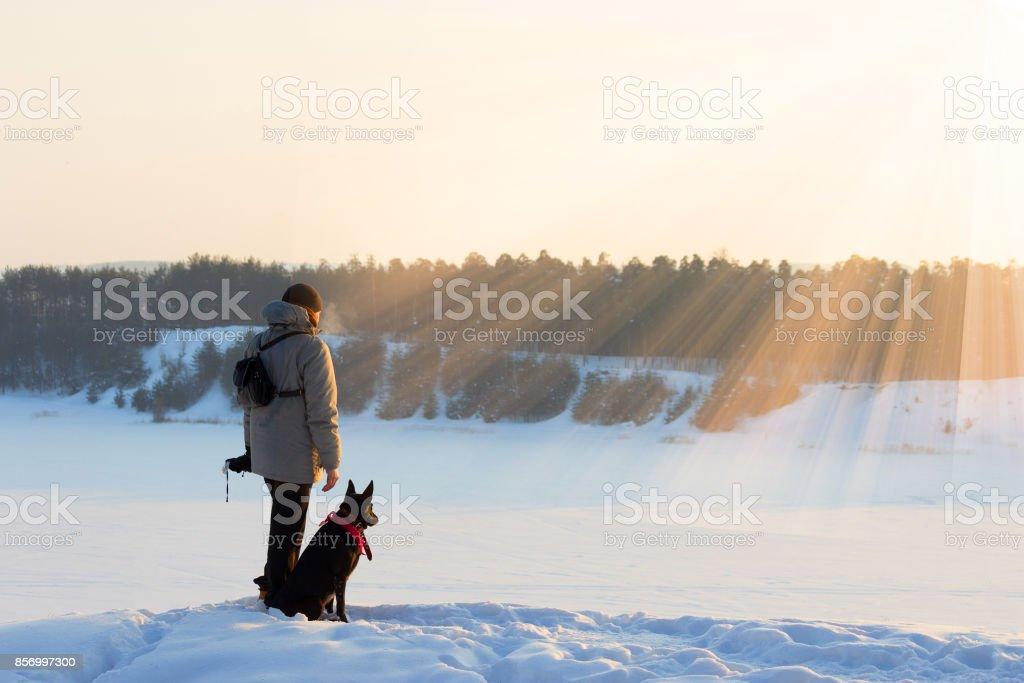 man with black dog. xtreme tourism, survival concept