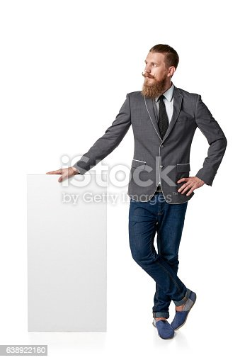 istock Man with blank banner 638922160