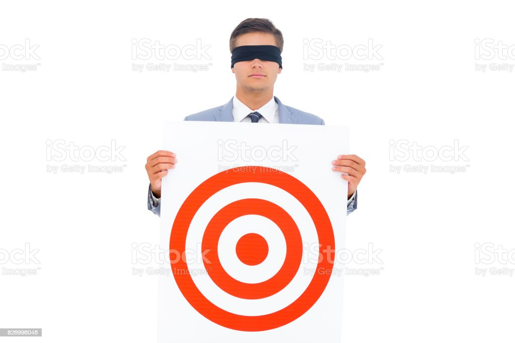 Man with blindfolded and a target stock photo