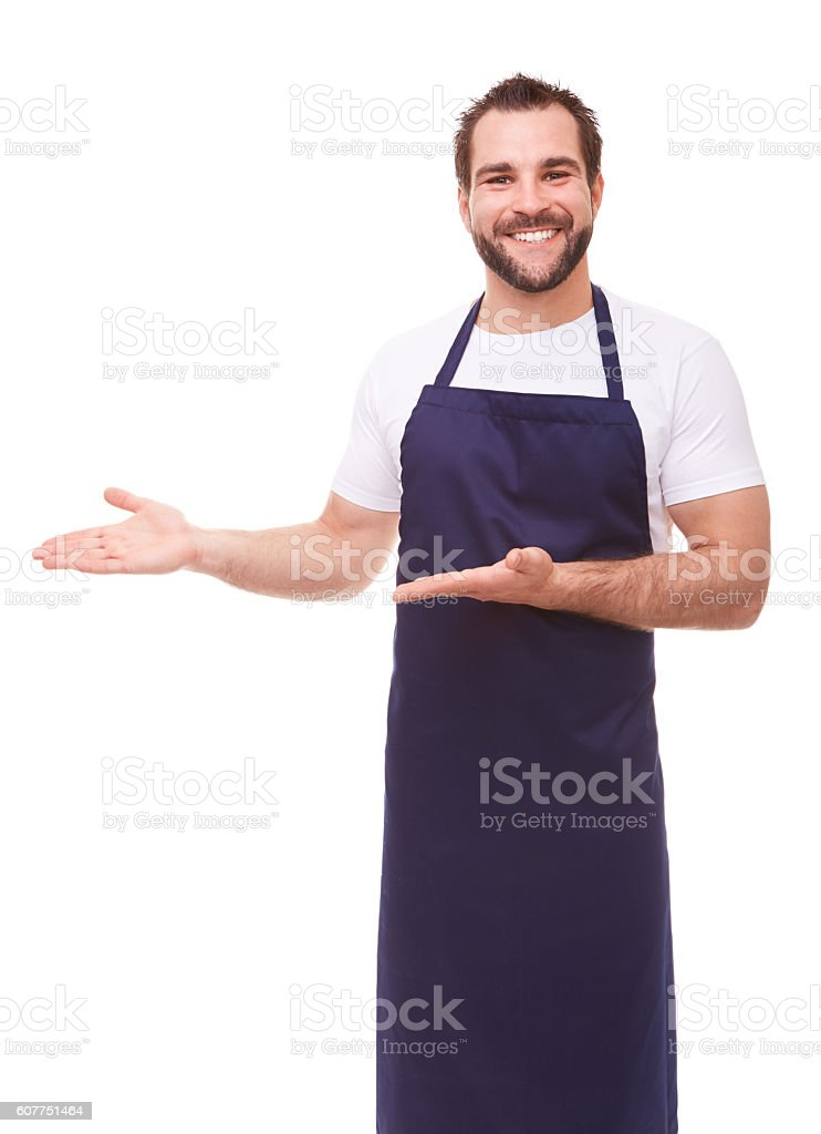 Man with blue apron stock photo