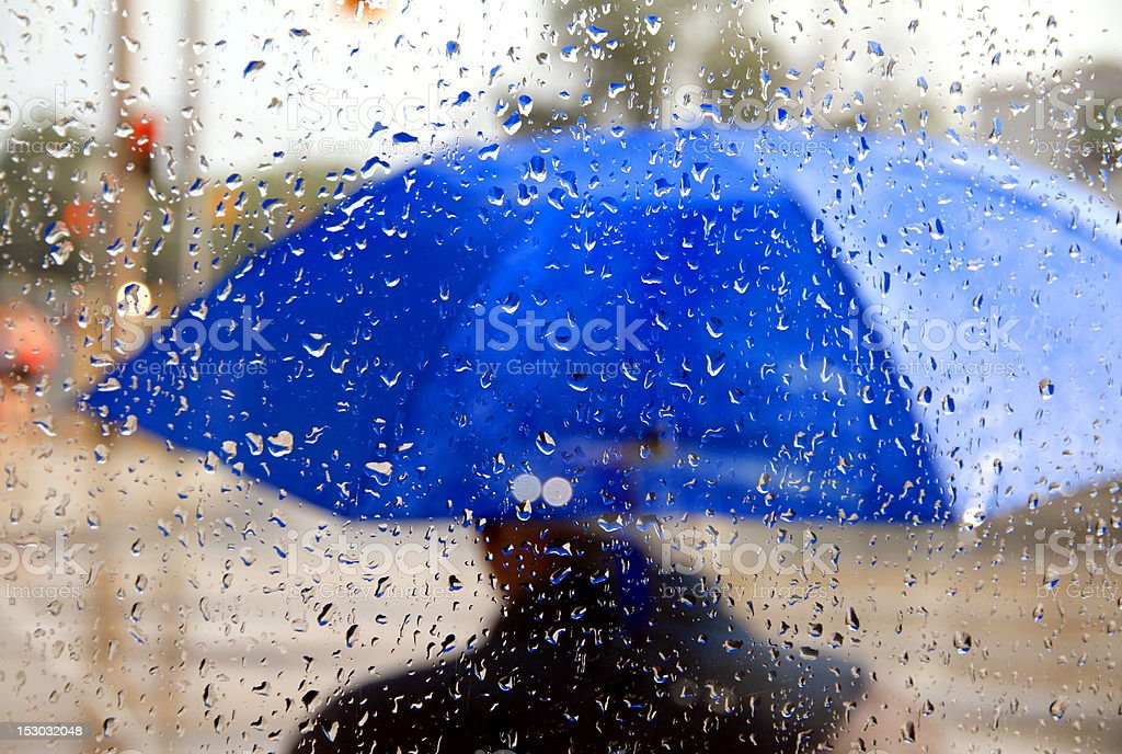 Man With Blue Umbrella stock photo