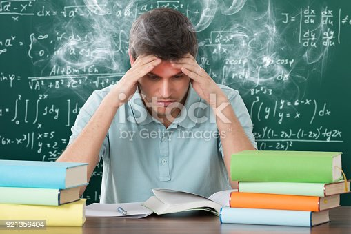 840623324istockphoto Man With Books At Desk 921356404