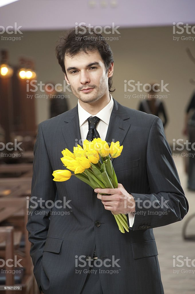 Man with bouquet of yellow tulip royalty-free stock photo