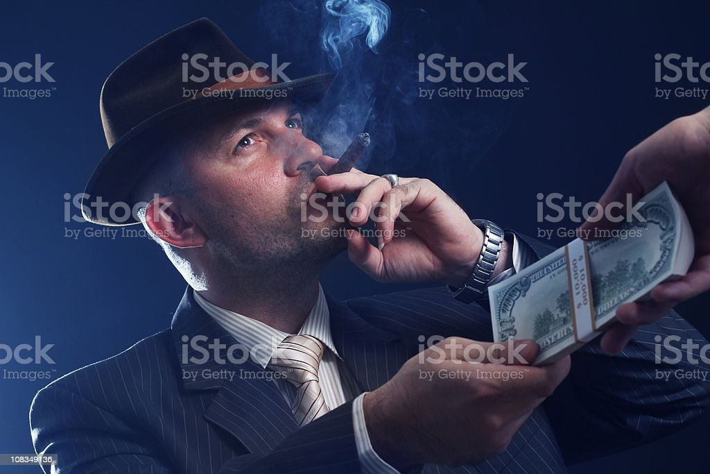 Man with bowler hat and cigar stock photo