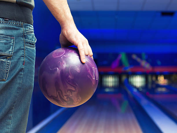 Man with bowling ball stock photo