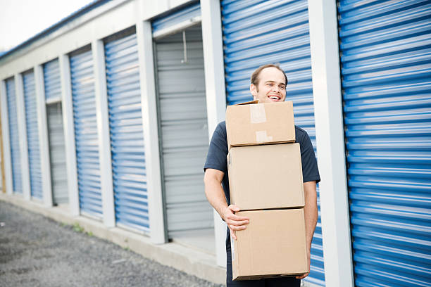 Man with Boxes Moving Company at Self Storage stock photo