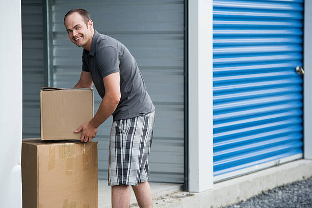 Man with Boxes Outside Self Storage Unit Lifestyle stock photo