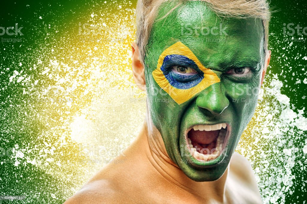 man with brazil flag painted on face - foto de acervo
