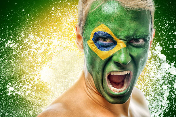 man with brazil flag painted on face stock photo