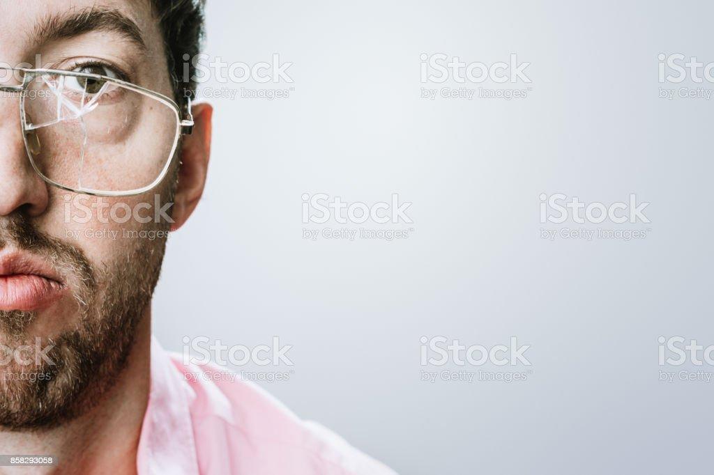 Man With Broken Eyeglasses stock photo