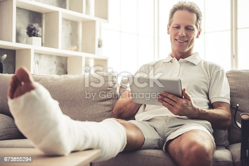 istock Man with broken leg 673855294
