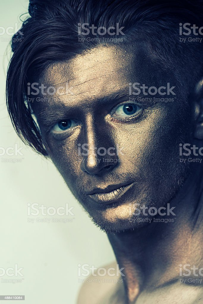 Man with bronze face stock photo