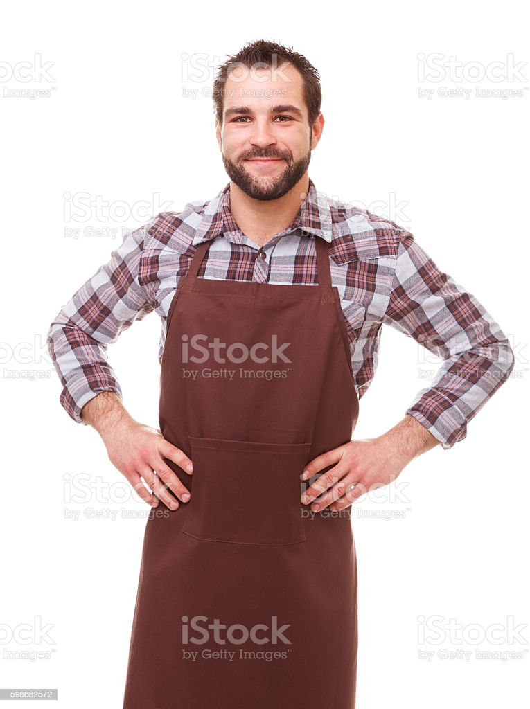 Man with brown apron stock photo