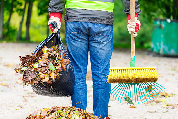 Man with brush Man with brush and rake collects leaves street sweeper stock pictures, royalty-free photos & images