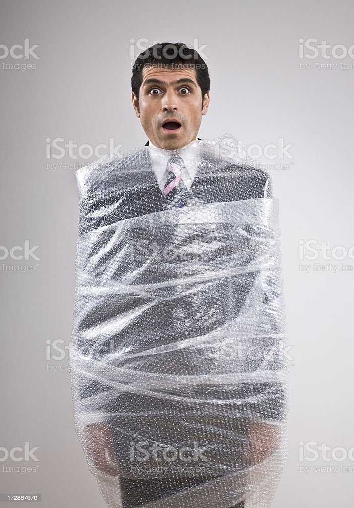 Man with bubble wrap around his body stock photo