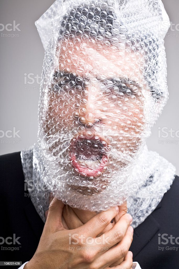 Man with bubble wrap around his head stock photo