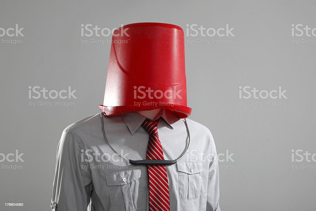 Man with Bucket on Head stock photo