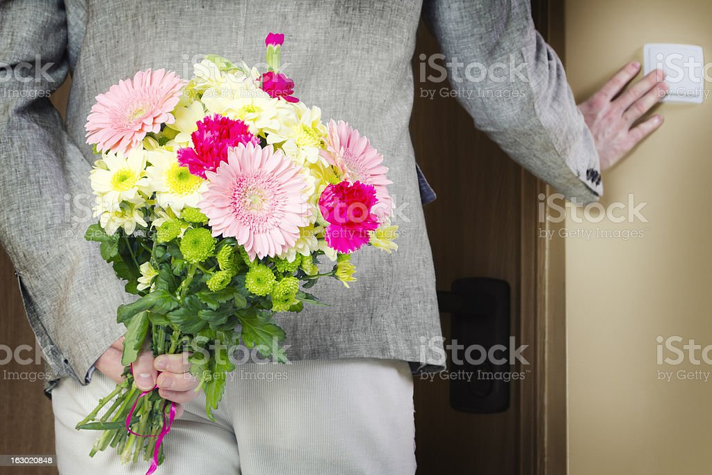 Man with bunch of flowers stock photo