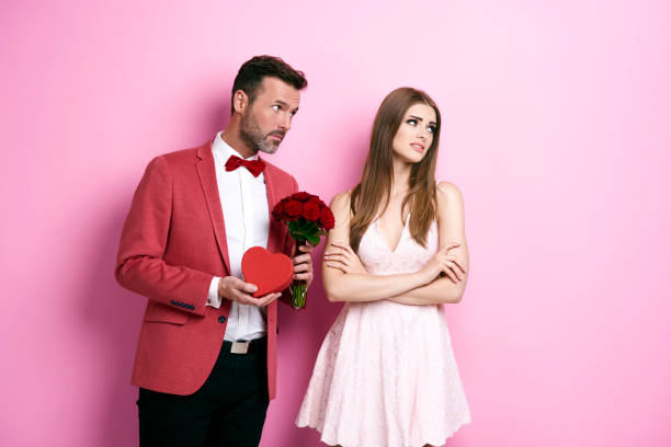 Man with bunch of rose and chocolate box apologizing fiance Man with bunch of rose and chocolate box apologizing fiance rejection stock pictures, royalty-free photos & images