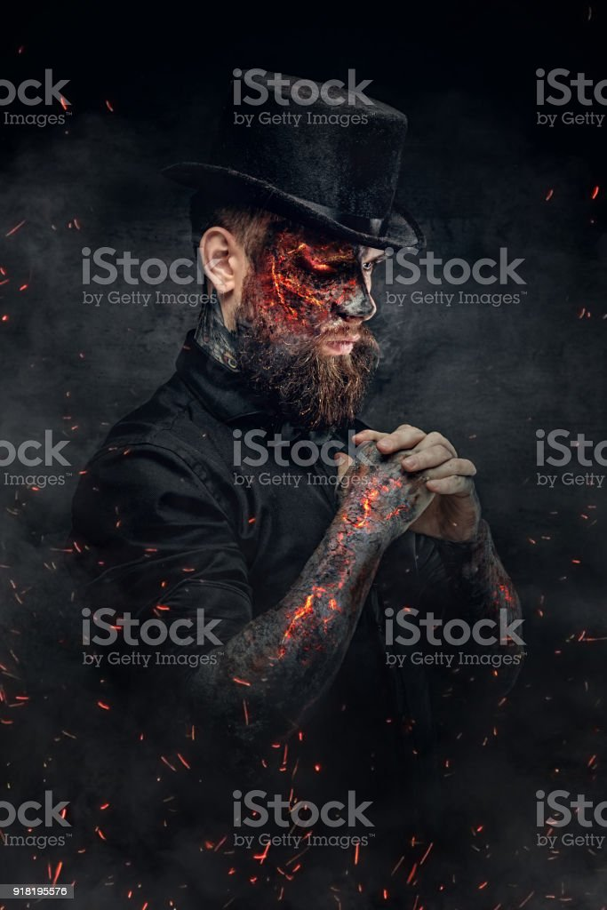 A man with burning face and arm. stock photo