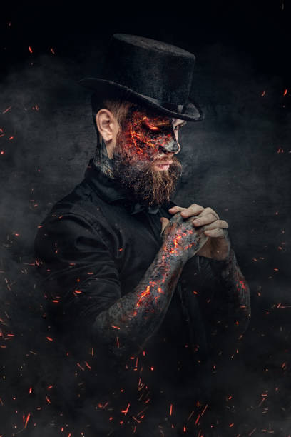 a man with burning face and arm. - daimon foto e immagini stock
