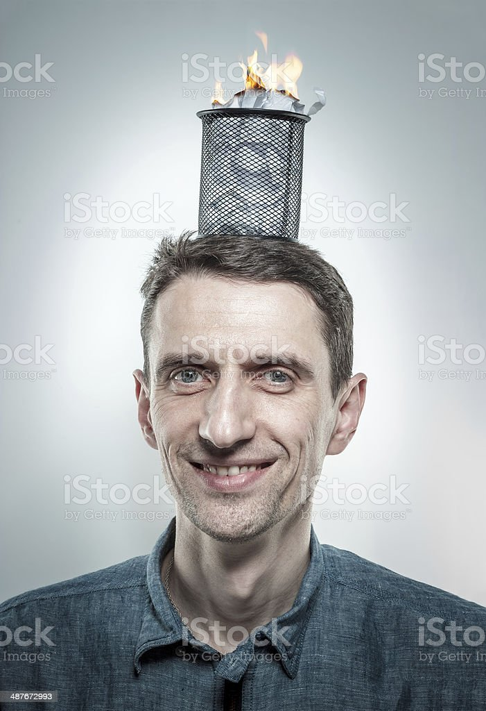 man with burning paperbin on his head royalty-free stock photo