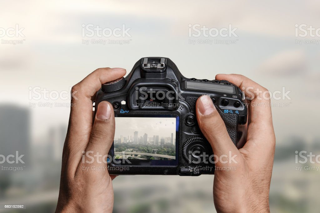 Man with camera in hands stock photo
