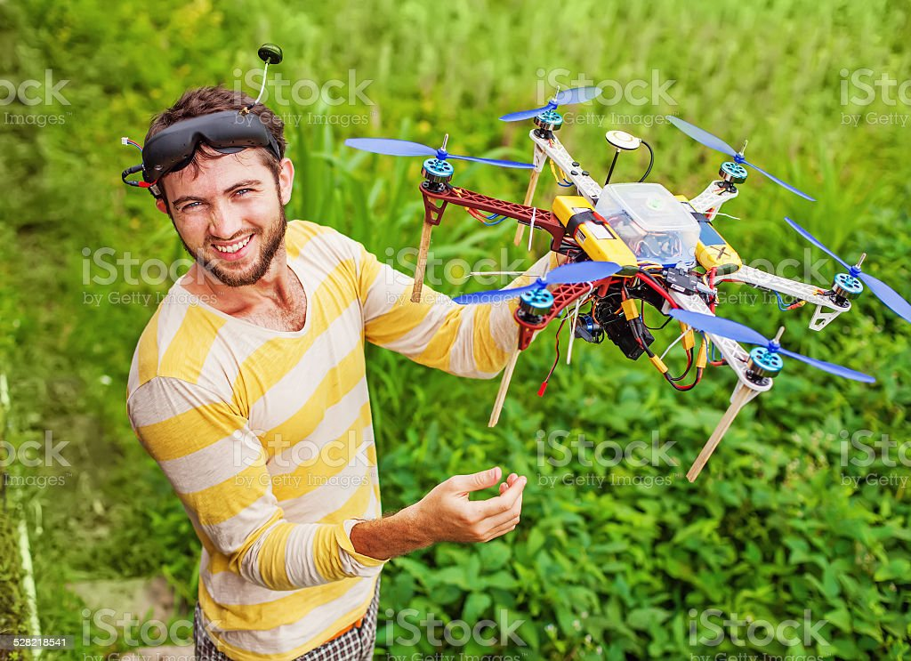 Man with camera rc copter stock photo