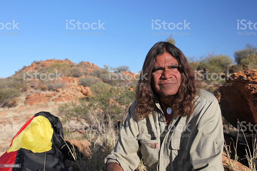 Man with camping gear in Australian outback stock photo
