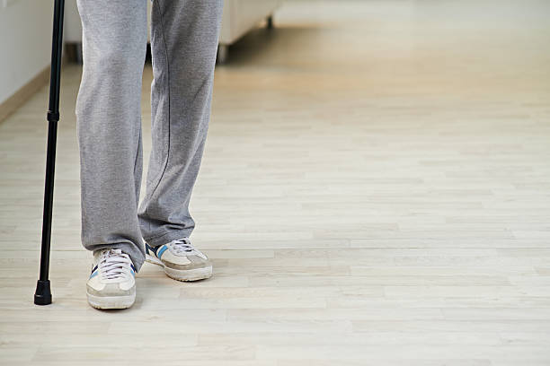 man with cane - old man feet stock photos and pictures