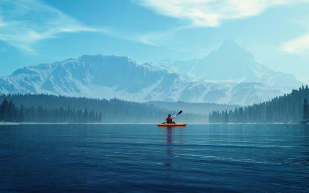 hombre con canoa en el lago. - kayak fotografías e imágenes de stock