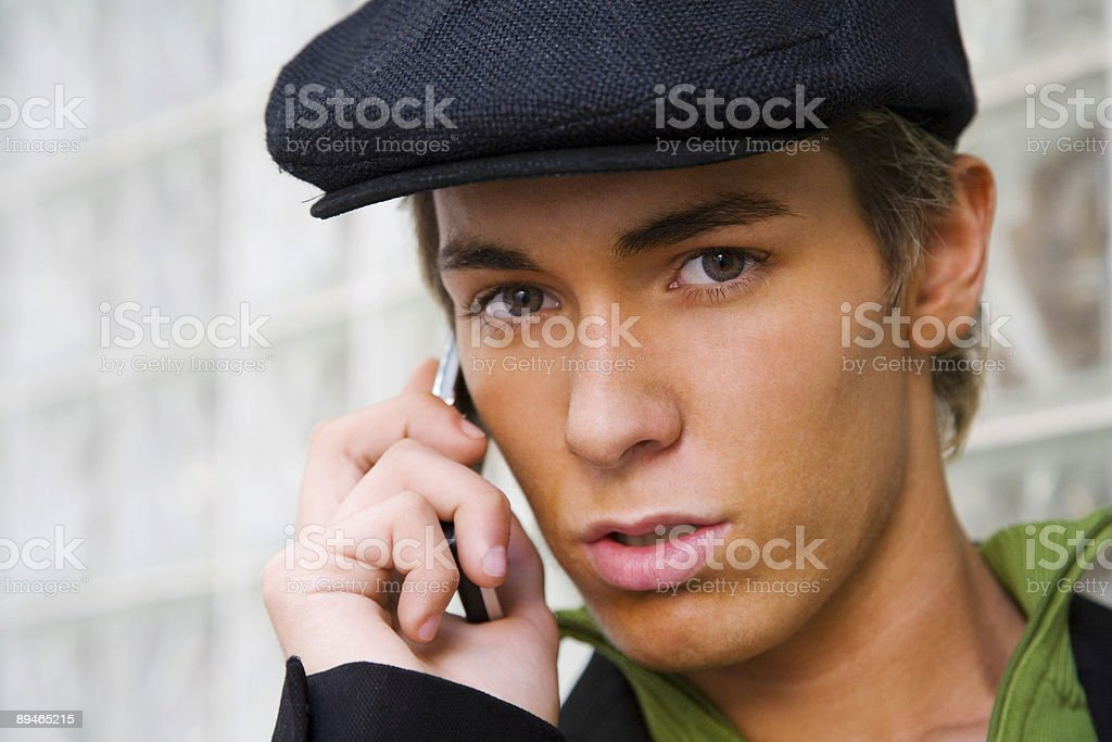 Man with cap and cell royalty-free stock photo
