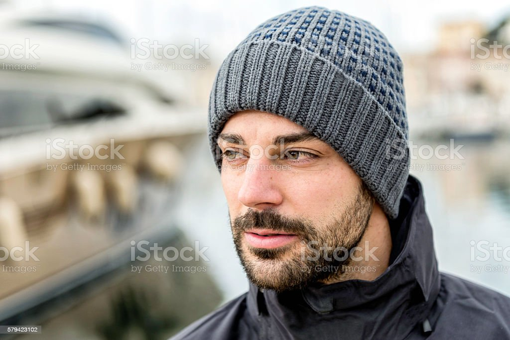Man with cap in port stock photo