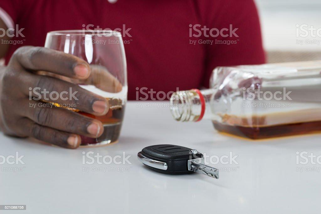 Man With Car Key Consuming Alcohol stock photo