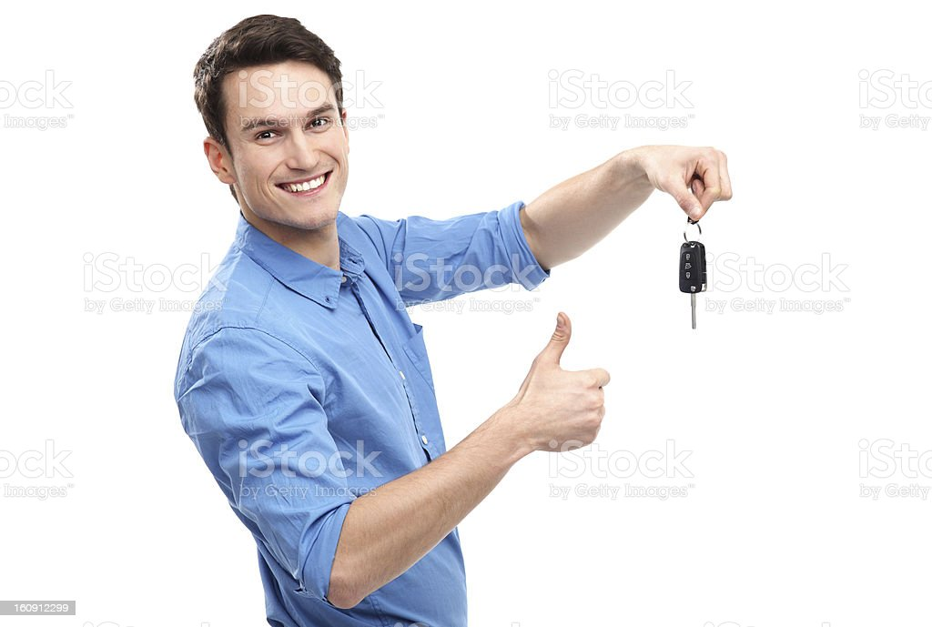 Man with Car Keys and Thumbs Up stock photo