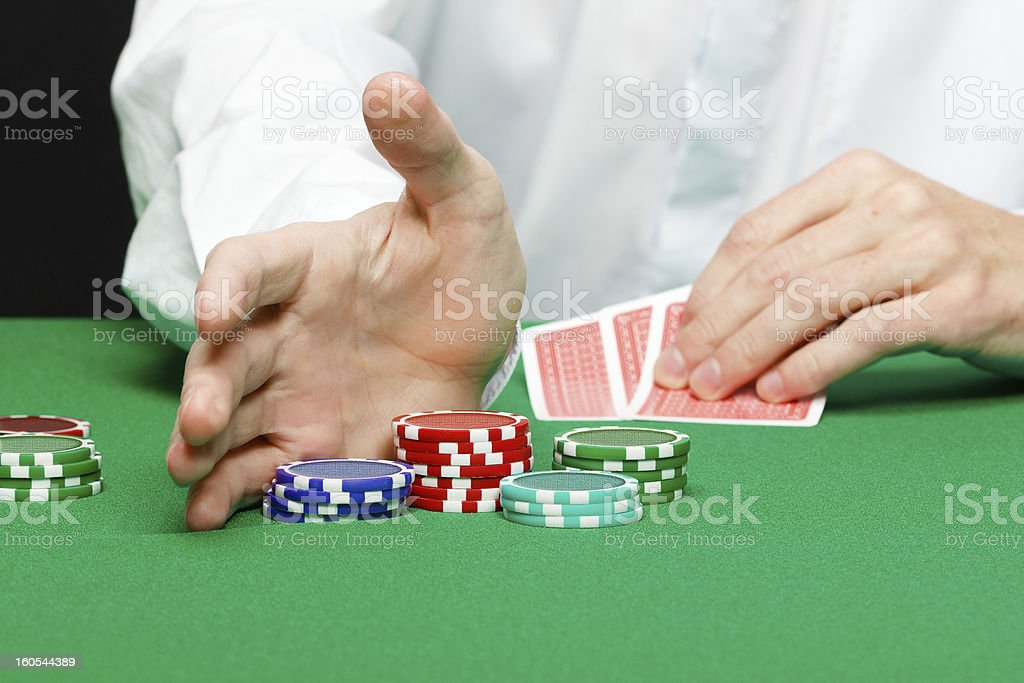 Man with cards on a gambling table royalty-free stock photo