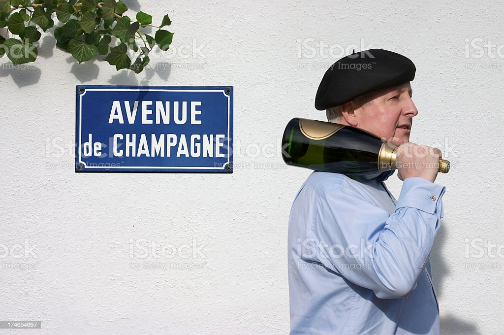 Man with Champagne passing sign saying Avenue de Champagne stock photo