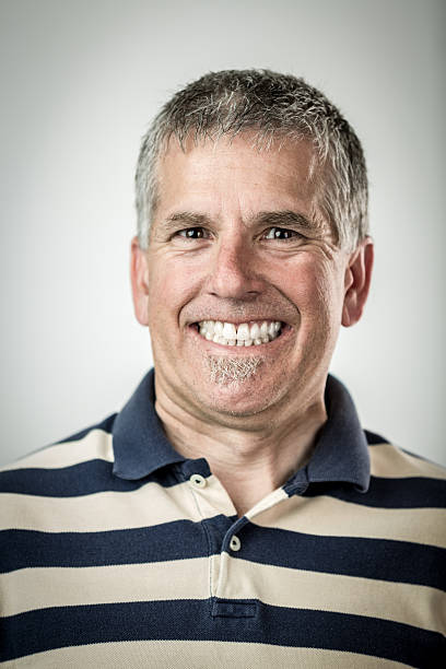 Man with Cheesy Grin Man with Cheesy Grin shallow depth of field cheesy grin stock pictures, royalty-free photos & images