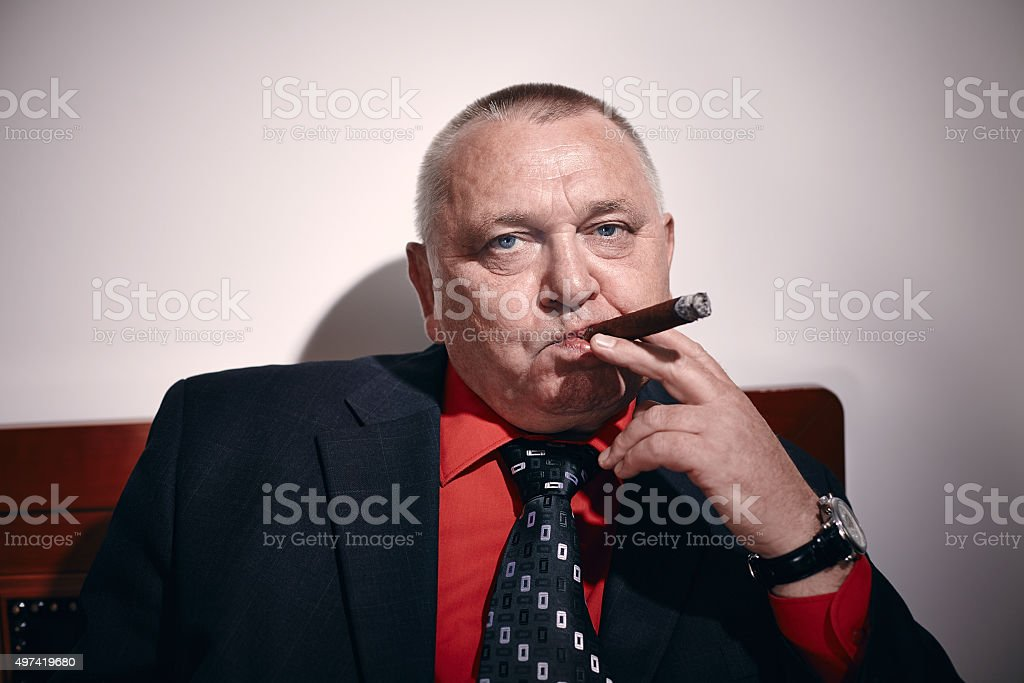 Man with cigar stock photo