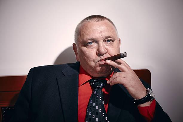 man with cigar - guy with cigar stockfoto's en -beelden