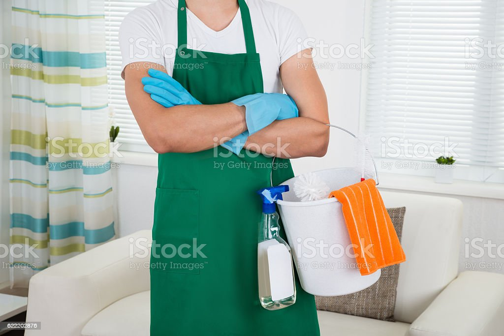 Man With Cleaning Equipment Standing Arms Crossed stock photo