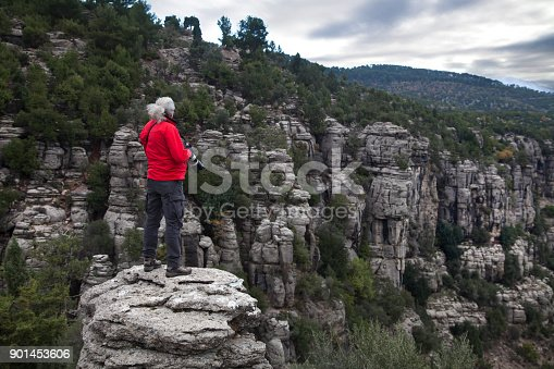 istock man with cliff 901453606