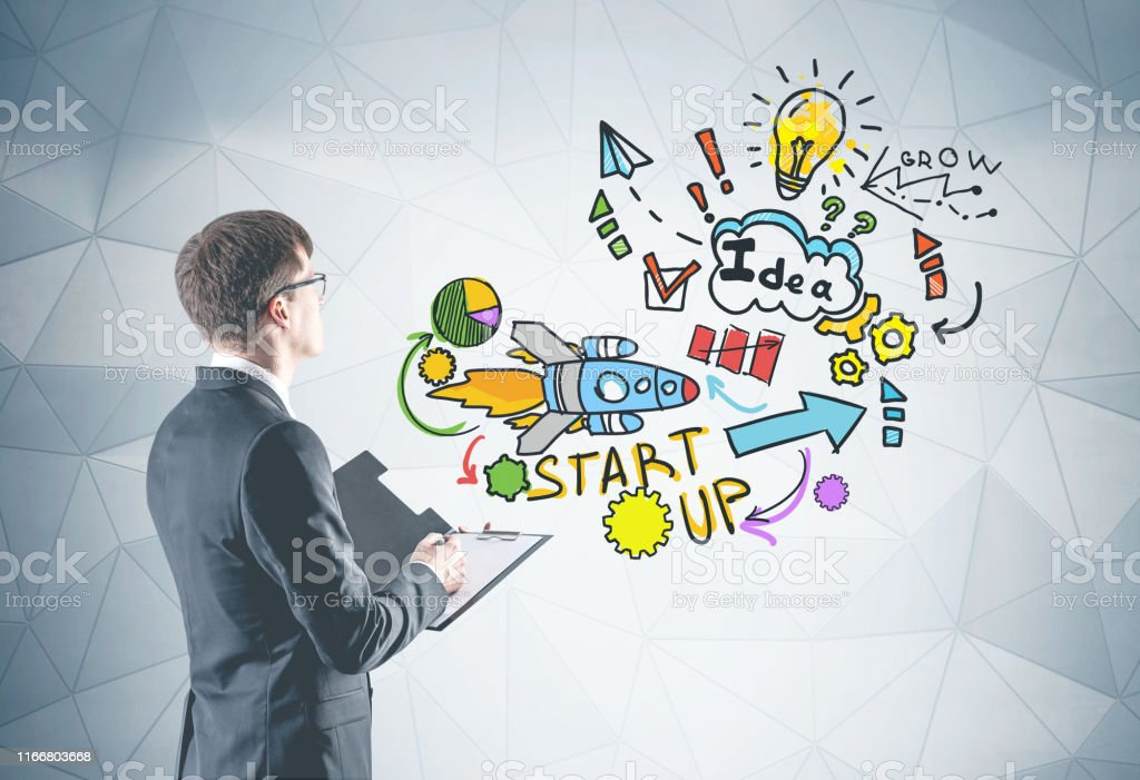 Man With Clipboard Looking At Start Up Sketch Stock Photo Download Image Now Istock