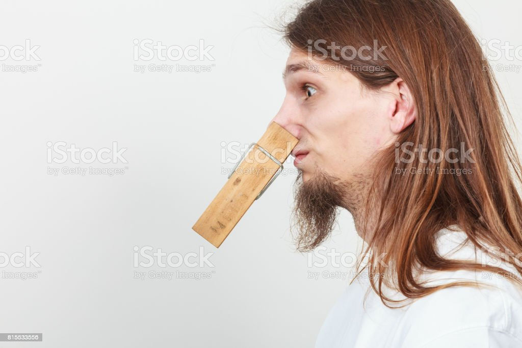 Man with clothespin on nose stock photo